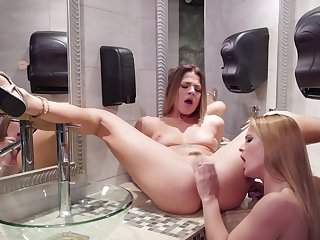 Lesbian vibrator play prevalent the bathroom with two hotties