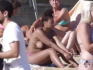 Cute Dusky Piece of baggage Topless Outdoors On UK Bournemouth Beach '16
