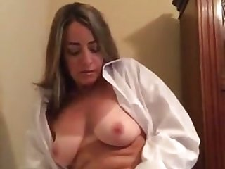 Disconsolate cam MILF unbuttons her white blouse to expose Bristols