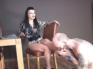 Miss Velour drills the brush pussy with a dildo while a slave licks the brush feet
