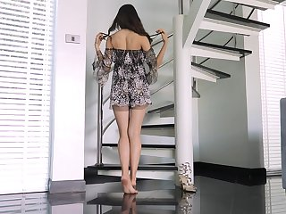 Petite girl stands scant and offers a great view to her pussy