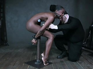 Meek ebony model Amari Anne gets the brush pussy toyed in the BDSM room