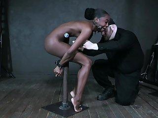 Meek ebony model Amari Anne gets the brush pussy toyed in the BDSM room