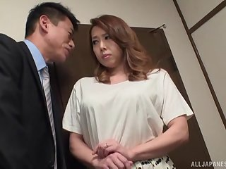 Naughty neighbor's wife Yumi Kazama drops on the top of her knees to almost head
